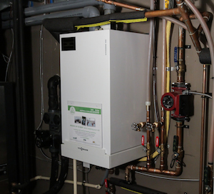 High efficiency boiler in a white metal housing