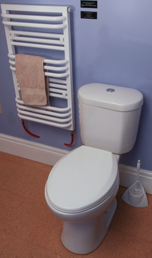 A toilet which looks like any other toilet but uses less water than other efficient toilets