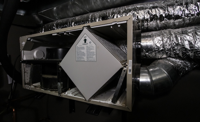 Opened up air exchange system showing the diamond shaped filter and exchanger